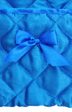 Blue silk background. With a bow Royalty Free Stock Photography