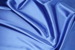 Blue silk. Background with some soft folds and highlights Royalty Free Stock Photo