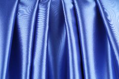 Blue silk. Background with some soft folds and highlights royalty free stock images