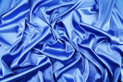 Blue silk. Background with some soft folds and highlights stock photography