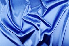 Blue silk background. With some soft folds and highlights royalty free stock image