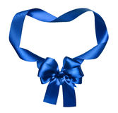 Blue silk bow and ribbon decoration object on white as frame Royalty Free Stock Photos