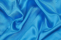 Blue Silk cloth of wavy abstract background Royalty Free Stock Photography