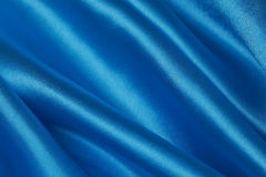 Blue Silk cloth of wavy abstract background Royalty Free Stock Photos