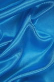 Blue Silk cloth of wavy abstract background Stock Photos