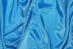 Blue Silk cloth of wavy abstract background Royalty Free Stock Images
