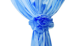 Blue silk curtains with bow  on white background Royalty Free Stock Photography