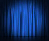 Blue silk curtains for theater and cinema spotlit Stock Photography