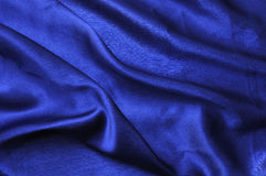 Blue silk drape Stock Images