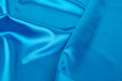 Blue silk drapery. Royalty Free Stock Photos