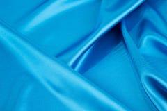 Blue silk drapery. Royalty Free Stock Image