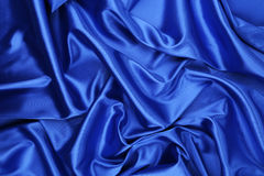 Blue silk drapery. Located as a whole background Royalty Free Stock Images