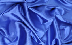 Blue silk drapery. Located as a whole background Royalty Free Stock Image