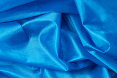 Blue silk fabric background Royalty Free Stock Photography