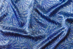 Blue silk fabric background with abstract pattern Royalty Free Stock Images
