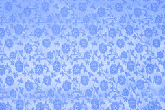 Blue silk with flowers as background Stock Images