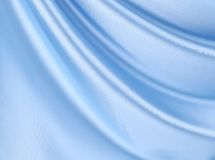 Blue silk. Blue ik background with some soft folds and highlights stock photography