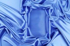 Blue silk soft folds as frame. Royalty Free Stock Photography