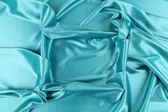 Blue silk soft folds as frame. Stock Photo