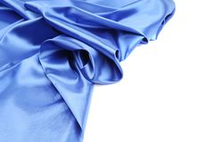 Blue silk with some soft folds and highlights. Whole background royalty free stock image