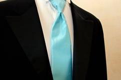 Blue silk tie. Silk tie accenting a black tuxedo Stock Photos