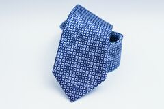 Blue silk tie with square patterns Stock Image
