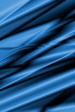 Blue Silk Wallpaper. Blue satin or silk with some smooth folds Stock Photo