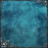 Blue & silver. Blue textured background with ornate silver border Stock Image