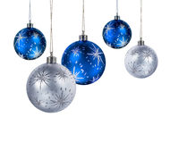 Blue silver christmas balls. Blue and silver Christmas balls hanging isolated on white background royalty free stock photo