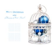 Blue and silver christmas balls in cage on  isolated Stock Photo