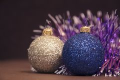 Blue and silver Christmas balls with a garland. Nice holidays decorations stock photos