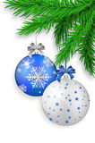 Blue and silver Christmas balls hanging on spruce twig Stock Photography