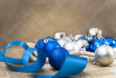 Blue and silver Christmas balls with ribbon close up Stock Photography