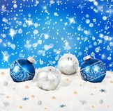Blue and silver Christmas balls on snow background. With stars royalty free stock image