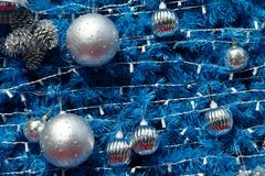 Blue and silver Christmas decoration. Detail of blue and silver Christmas tree Stock Image