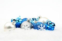 Blue,silver christmas decoration on snow stock images