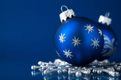 Blue and silver christmas ornaments on dark blue background with space for text Royalty Free Stock Image