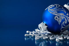Blue and silver christmas ornaments on dark blue background Royalty Free Stock Photography