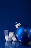 Blue and silver christmas ornaments on dark blue xmas background Stock Photography