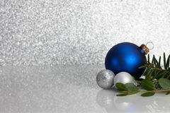 Blue and silver Christmas ornaments on glitter Royalty Free Stock Photo