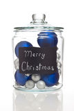 Blue and silver Christmas ornaments in jar Stock Photo