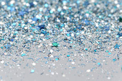 Blue and Silver Frozen Snow Winter Sparkling Stars Glitter background. Holiday, Christmas, New Year abstract texture. Blue and Silver Frozen Snow Winter Ice Cold