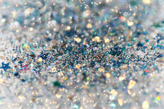Blue and Silver Frozen Snow Winter Sparkling Stars Glitter background. Holiday, Christmas, New Year abstract texture Stock Photos
