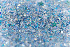 Blue and Silver Frozen Snow Winter Sparkling Stars Glitter background. Holiday, Christmas, New Year abstract texture Royalty Free Stock Images