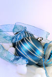 Blue and Silver Holiday. Ornaments with blue and silver   ribbon on a soft blue and lavender background Stock Photo