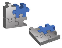 Blue and silver puzzle pieces Stock Photo