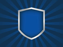 Blue and silver shield emblem on black background Royalty Free Stock Images