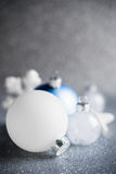 Blue, silver and white xmas ornaments on glitter holiday background. Merry christmas card. Royalty Free Stock Photography