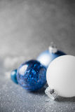 Blue, silver and white xmas ornaments on glitter holiday background. Merry christmas card. Stock Images