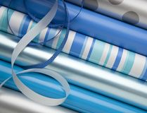 Blue, silver and while wrapping paper gift wrap and ribbons for Hanukkah holiday gifts presents